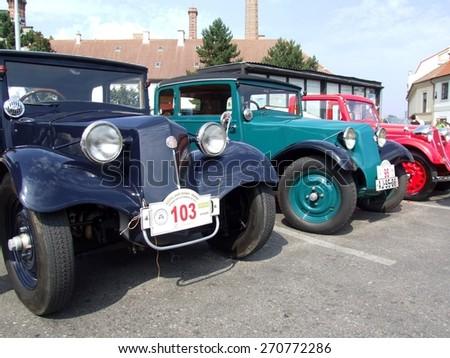 Prague - Zbraslav, Czech Republic - September 06, 2014: Three historic cars parked during veteran race - stock photo