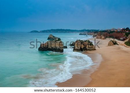 Praia da Rocha's beach area in the evening, Atlantic Ocean, Algarve, southern Portugal - stock photo