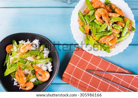prawn and snow peas on topped of the rice - stock photo