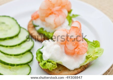 Prawn cocktail appetizer with cottage cheese and cucumber - stock photo
