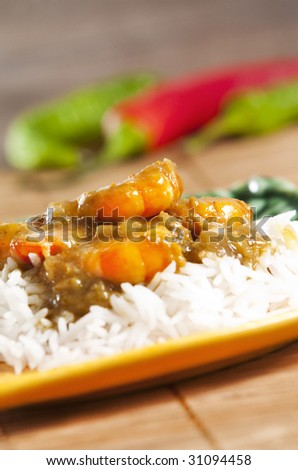 Prawn curry served  with basmati rice - stock photo