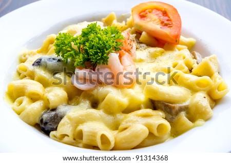 Prawn macaroni pasta with cheese and mushrooms - stock photo
