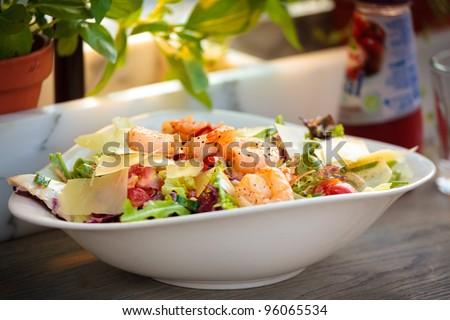 Prawn salad. Simple and healthy salad of shrimp, mixed greens and tomatoes - stock photo