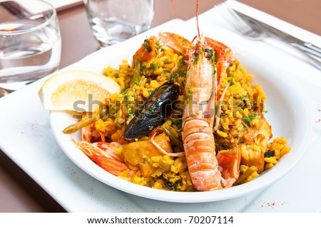 prawn with rice - traditional spanish food paella - stock photo