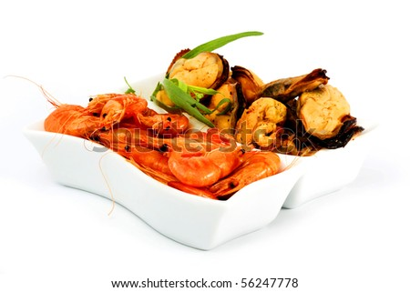 Prawns and mussels cooked with herbs on a white background - stock photo