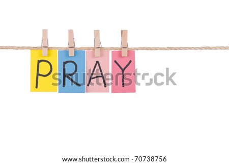 Pray, Colorful words hang on rope by wooden peg