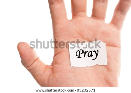 Pray words type on paper on hand