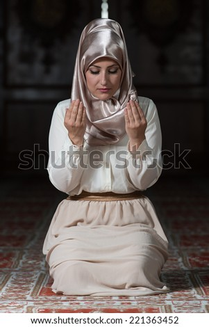 Prayer At Mosque - Young Muslim Woman Praying In Mosque - stock photo