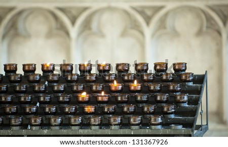 prayer candles at a church in rome