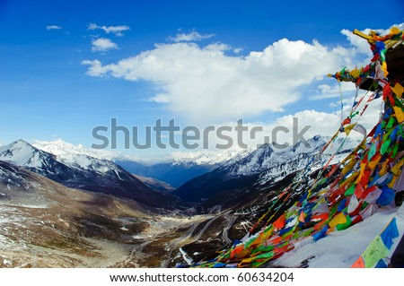 prayer flags and snow Mountain