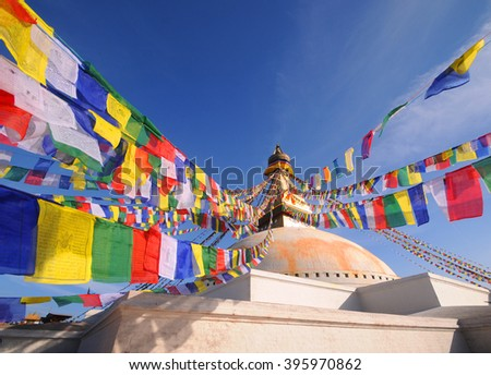 Prayer flags flying on the Boudhanath Stupa. symbol of Kathmandu, Nepal.