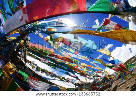 prayer flags on blue sky background - stock photo
