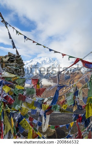 Prayer flags on Himalayan Summit - stock photo