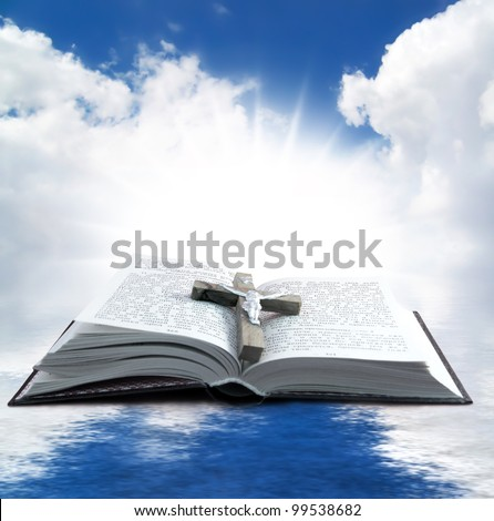 Prayer Holy book on the background of clouds and sun - stock photo