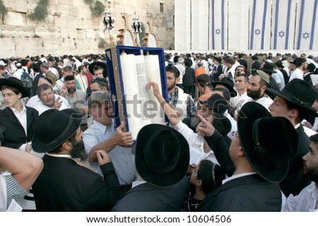 Prayer of Israelites with the roll Torah in western (wailing) wall in Jerusalem. - stock photo