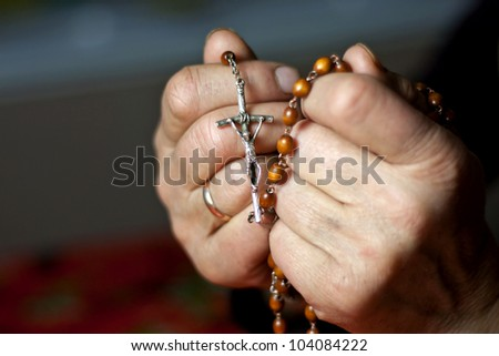 prayer old woman hands with rosary - stock photo