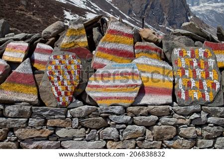 Prayer's stone along Everest base camp. - stock photo