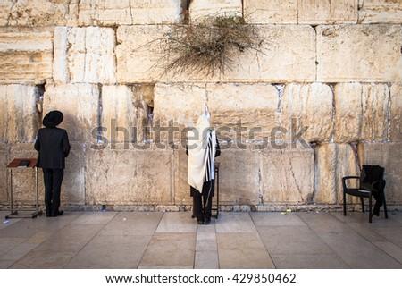 praying at western wall - stock photo