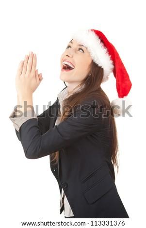 praying businesswoman in santa claus hat, white background - stock photo