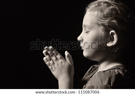 Praying child. OTHER PHOTOS FROM THIS SERIES IN MY PORTFOLIO. - stock photo