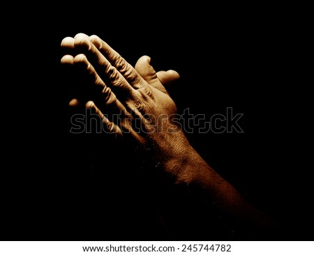 Praying Hands in black background - stock photo