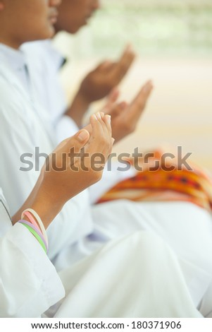 Praying hands of muslim boy. - stock photo
