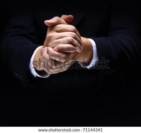 Praying hands on black backgroun - stock photo