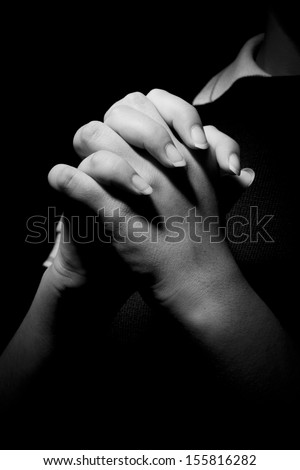Praying hands with a rosary  - stock photo