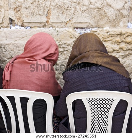 Praying in front Kotel - stock photo