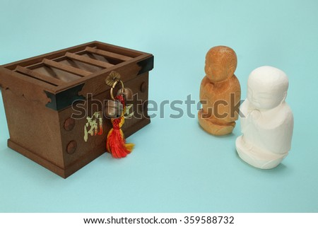"praying ksitigarbha and the offertory box in blue #2 Note: Japanese word of this photo means ""better fortune - stock photo"