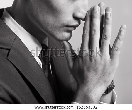 Praying man - stock photo