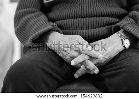 Praying old hands in black and white  - stock photo