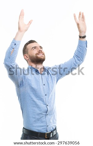 Praying to you. Handsome middle-aged man with beard raising his arms in air against isolated background  - stock photo