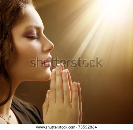 Praying Woman - stock photo