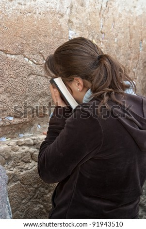 Praying women at the Wailing Wall in Jerusalem. - stock photo