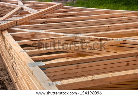 Pre-fab and cut lumber pile for easy set-up - stock photo