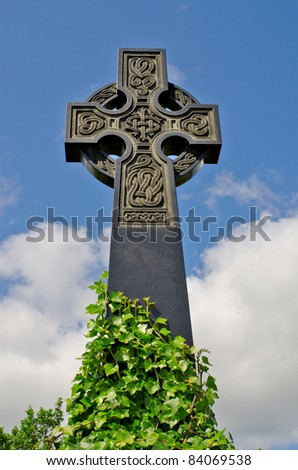 Pre 1900 irish celtic cross with traditional celtic carving from a grave in the famous Milltown Cemetery Belfast, the largest Catholic burial ground in Belfast synonymous with Irish Republicanism. - stock photo