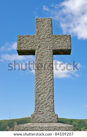 Pre 1900 irish granite cross with traditional carving on a grave in the famous Milltown Cemetery Belfast, the largest Catholic burial ground in Belfast and synonymous with Irish Republicanism. - stock photo