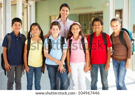Pre teen schoolchildren with teacher - stock photo