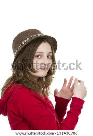 Pre teen young girl posing with a hat on white background - stock photo