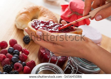 Preapering delicious sandwich with homemade marmalade - stock photo