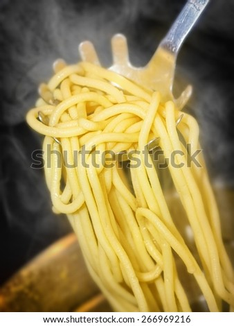 precisely cooked spaghetti with steam around - stock photo