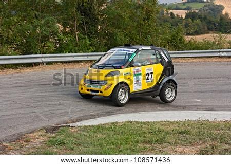 PREDAPPIO, ITALY - JULY 21: unidentified driver on a Mercedes Smart in hairpin bend at rally Predappio legend 2012, historical italian uphill race, on July 21, 2012 in Predappio, FC, Italy - stock photo