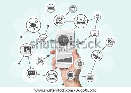 Predictive analytics and big data concept with hand holding modern smart phone to analyze information from marketing, shopping, cloud computing and mobile devices - stock photo