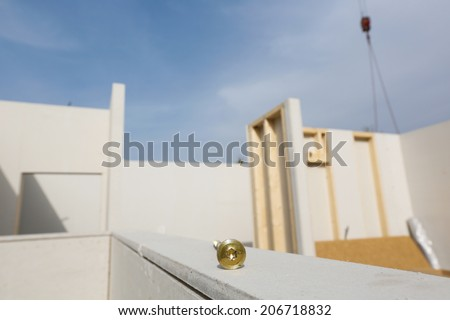 Prefabricated house in the making with screw in focus - stock photo