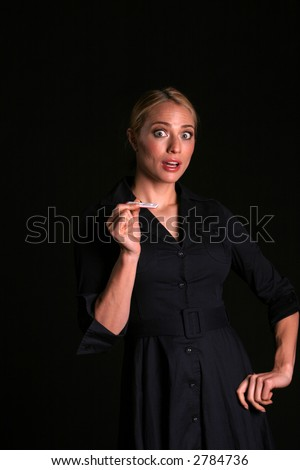 pregnancy concepts could be happy or upset  a young woman is shocked and upset at the news of being pregnant - stock photo