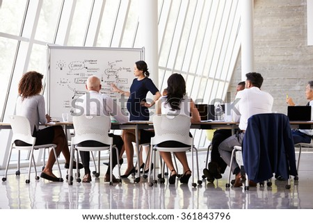 Pregnant Businesswoman Leads Boardroom Meeting - stock photo