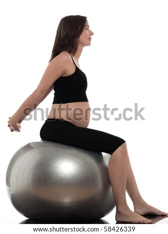 pregnant caucasian woman stretching on fitness ball isolated studio on white background - stock photo