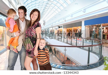 pregnant family in universal store - stock photo