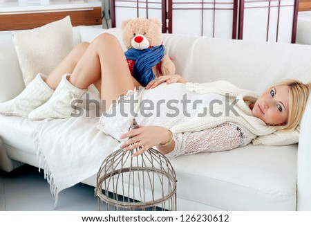 pregnant girl hugging a teddy bear - stock photo